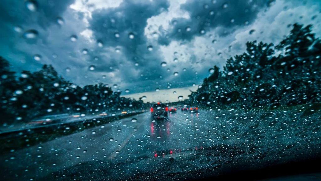 Driving in rain - rainy streets photo through windshield