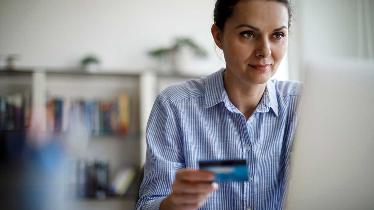 Buy Car Insurance Online - woman shopping online and holding a credit card