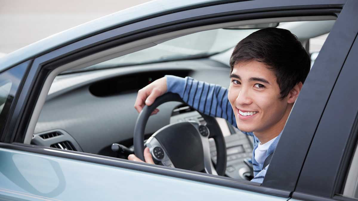 Cheap car insurance for new drivers - young man in new car