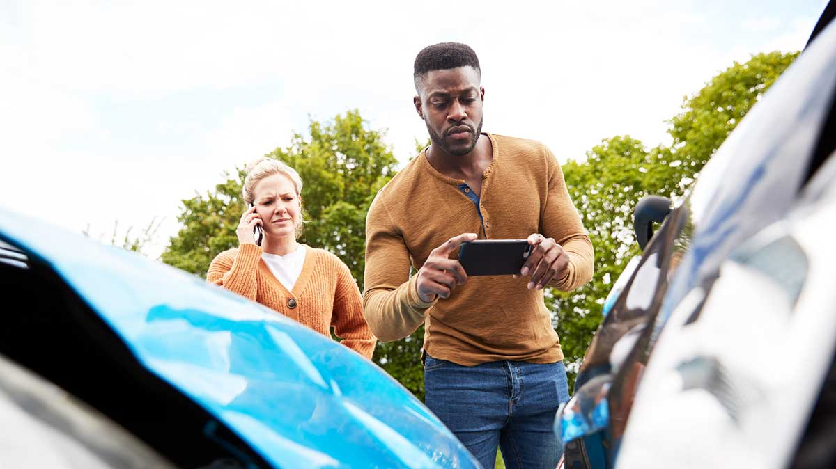 Collision Insurance - Two People Calling Insurance After An Accident