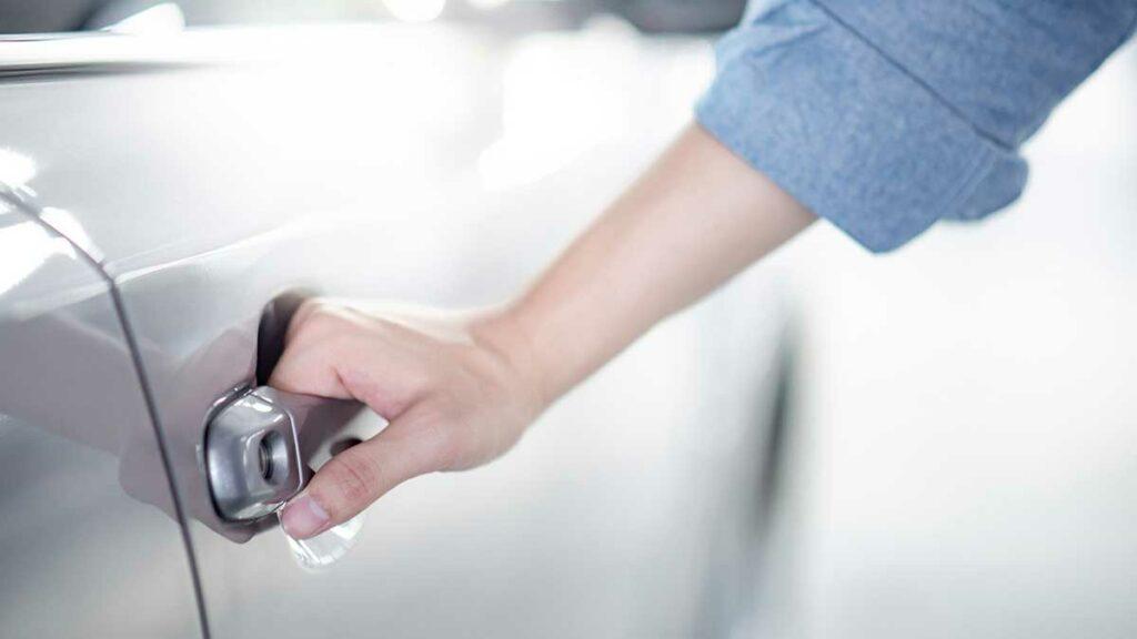 Liability car insurance - woman opening car door
